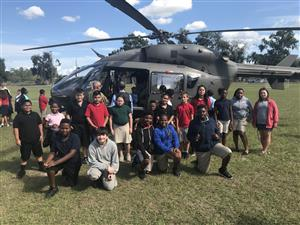 class in front of the helicopter