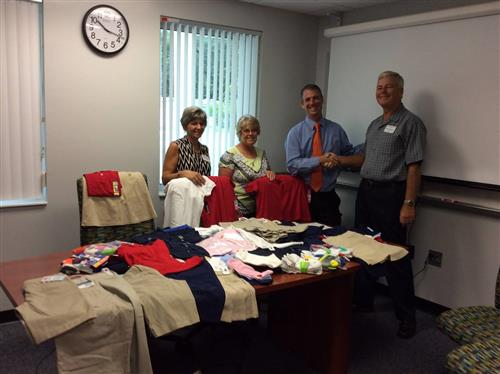 baby boomers club members presenting donations to Mr. Temple, principal of wildwood elementary