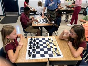 4th and 5th grade students playing chess in afterschool