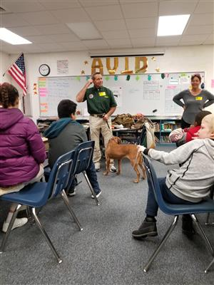 Career day presenter with dog in a classroom