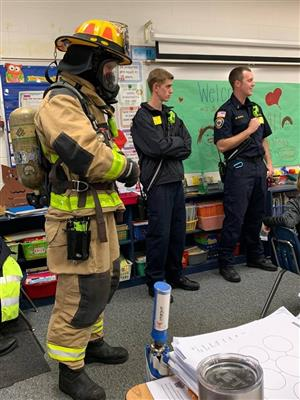 fire fighters presenting in a classroom for career day