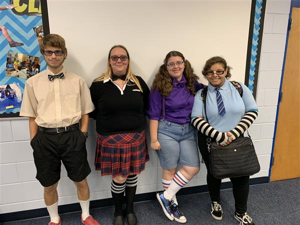 Four students dressed like nerds