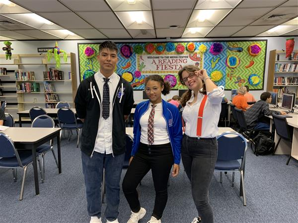 Three students dressed like nerds