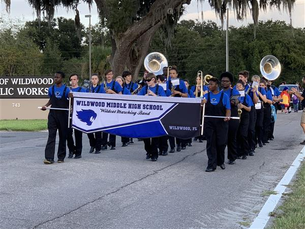 The WMHS band walking in formation down the street.