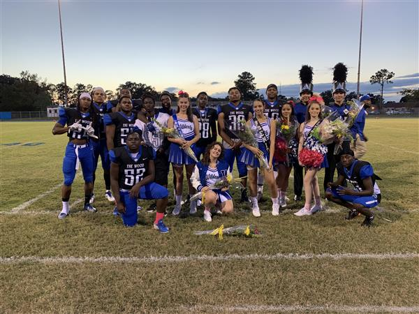 A group picture of senior football players, cheerleaders, and band members.