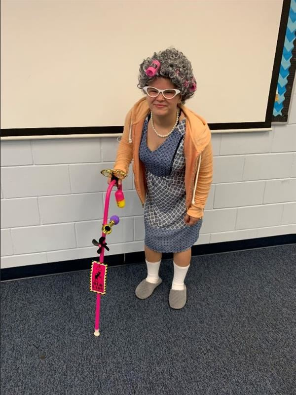 A student dressed like an elderly lady
