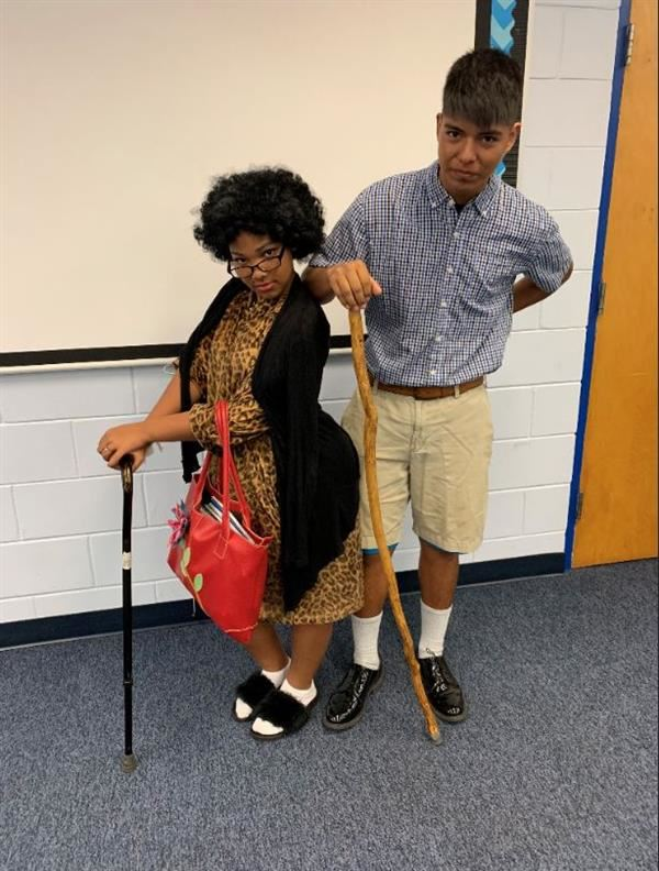 Two students dressed as elderly people