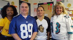 staff in team spirit shirts