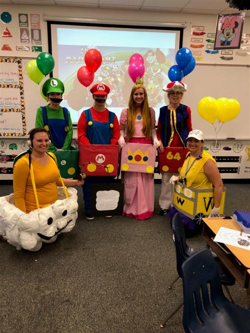 Kindergarten teachers dressed up as mario cart characters for halloween