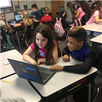 two students sharing a computer and working on code