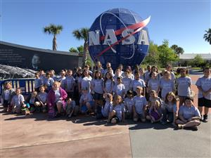 Gifted Students posing in front on NASA Globe