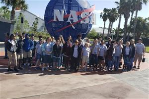 Middle School students standing in front of NASA Globe