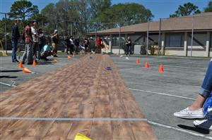 Solar Car Track surrounded by students watching race