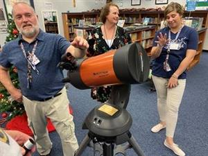 Pictures of teacher and faculty and new telescope