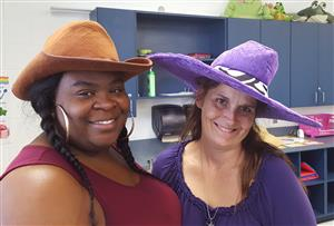 two teachers with crazy hats